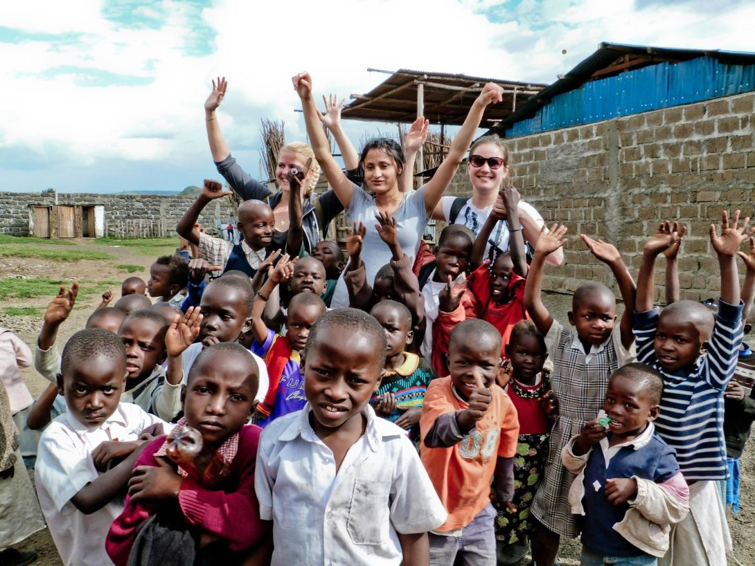 Care volunteers with school children in Africa